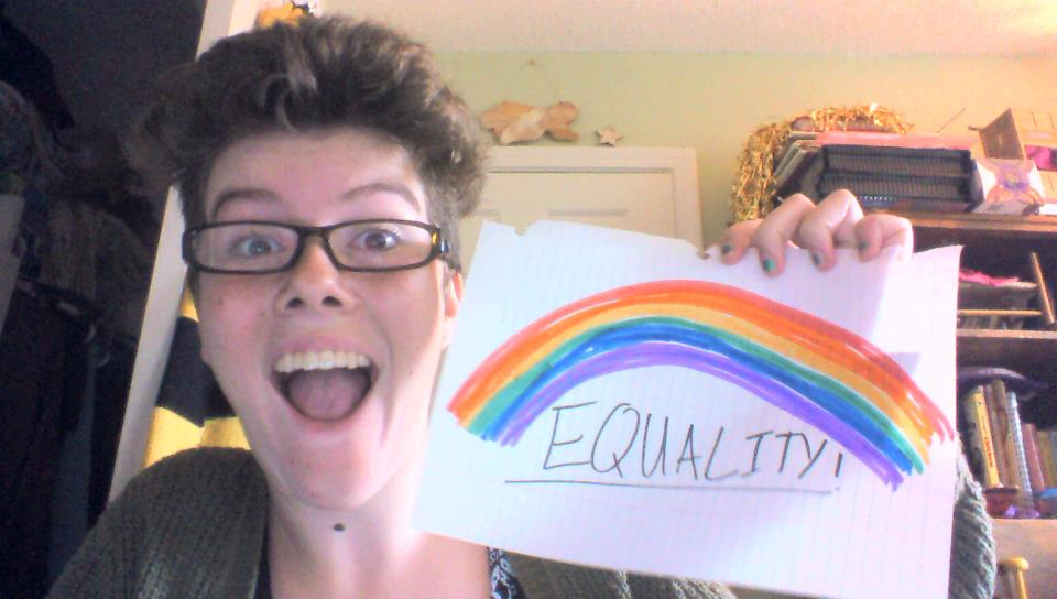 Picture of me holding a rainbow that I drew for the occasion.